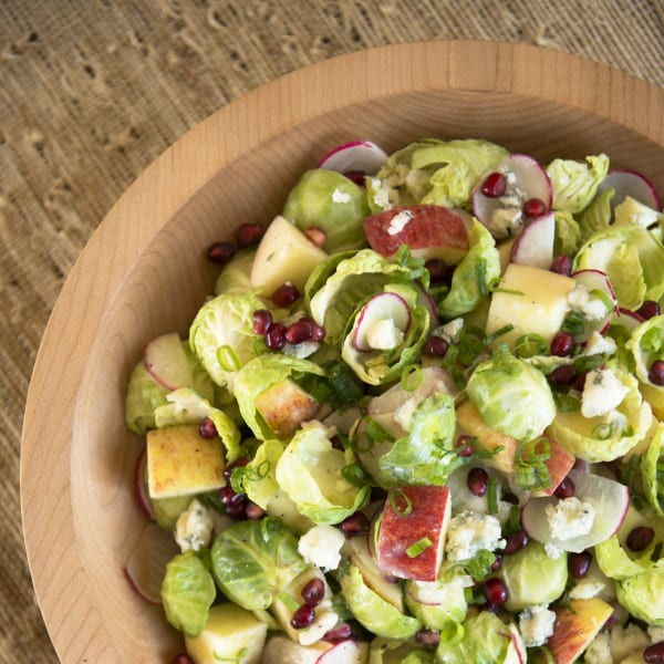 Apple, Radish, and Brussels Sprout Salad with Pomegranate and Blue Cheese Honey Vinaigrette