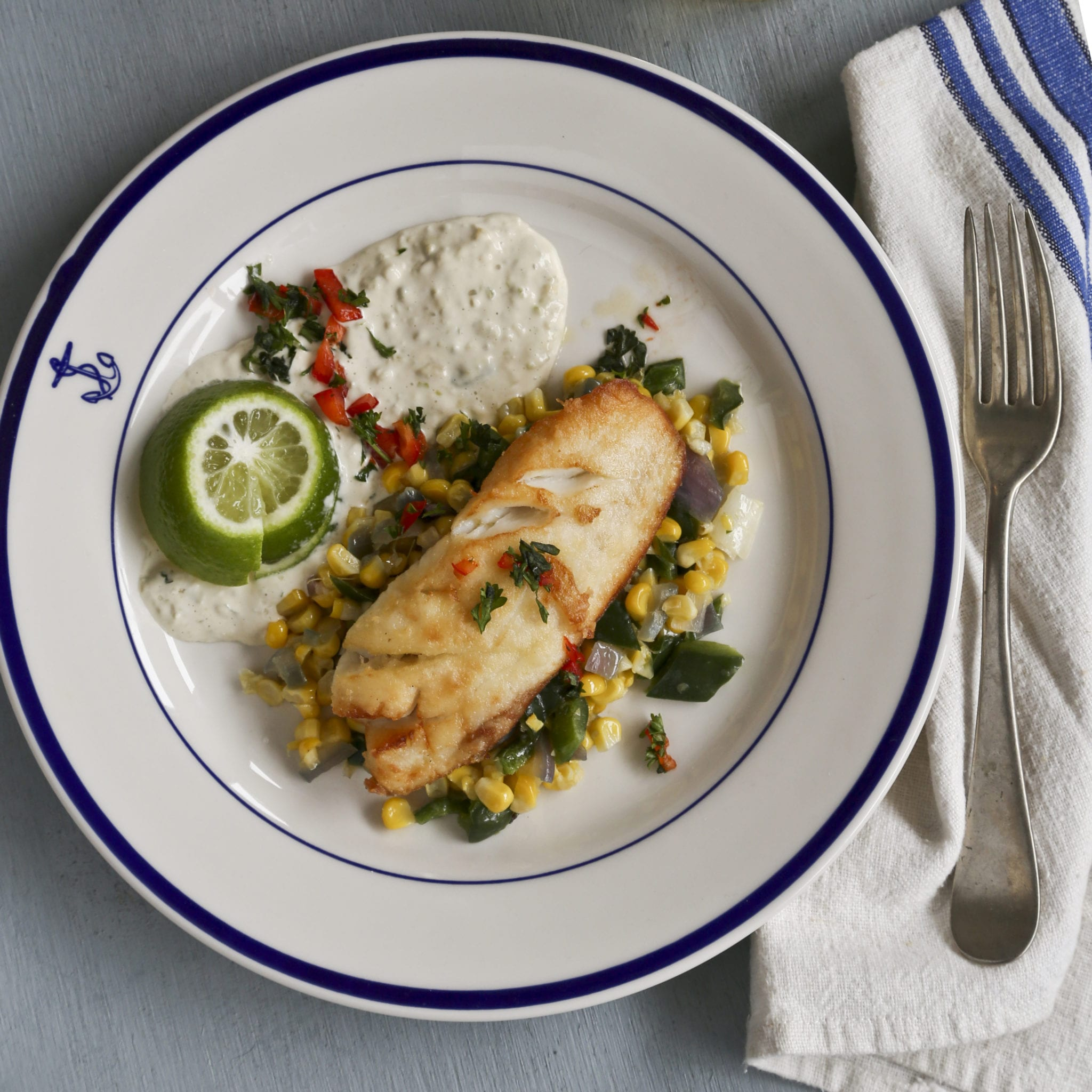 Cajun fish fillets with corn and chile pepper saut and for Cajun fish recipe