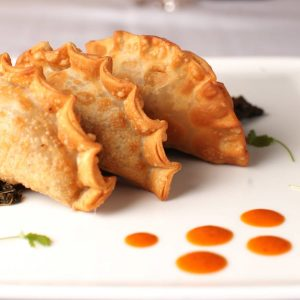 Chorizo and Collard Green Empanadas in Nuevo Latino
