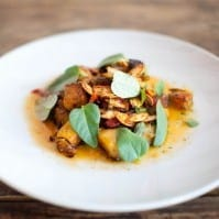 Oven Roasted Heirloom Pumpkin with Calabrian Chilies, Fresh Curry Leaves, and Sorghum Vinaigrette