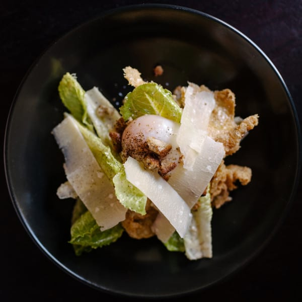 """Chicken"" Caesar Salad with Schmaltz Dressing, Poached Egg, and Crispy Chicken Skin"