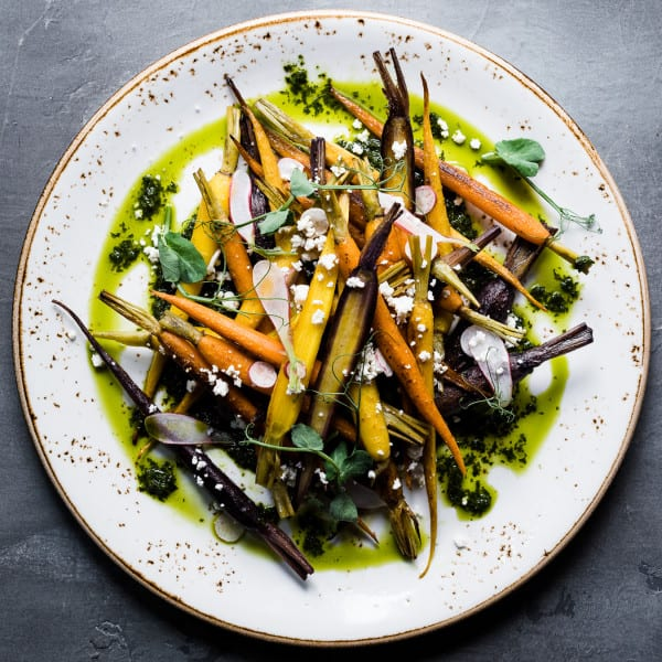 Roasted Carrots, Carrot Top Chimichurri, Radish, Queso Fresco, and Pea Greens