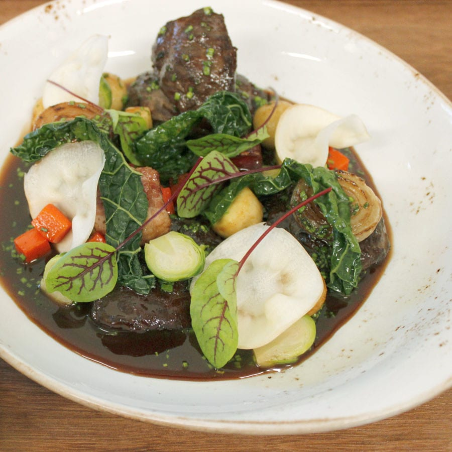 Braised Pork with Apples, Smoked Grits and Roasted Root Vegetables