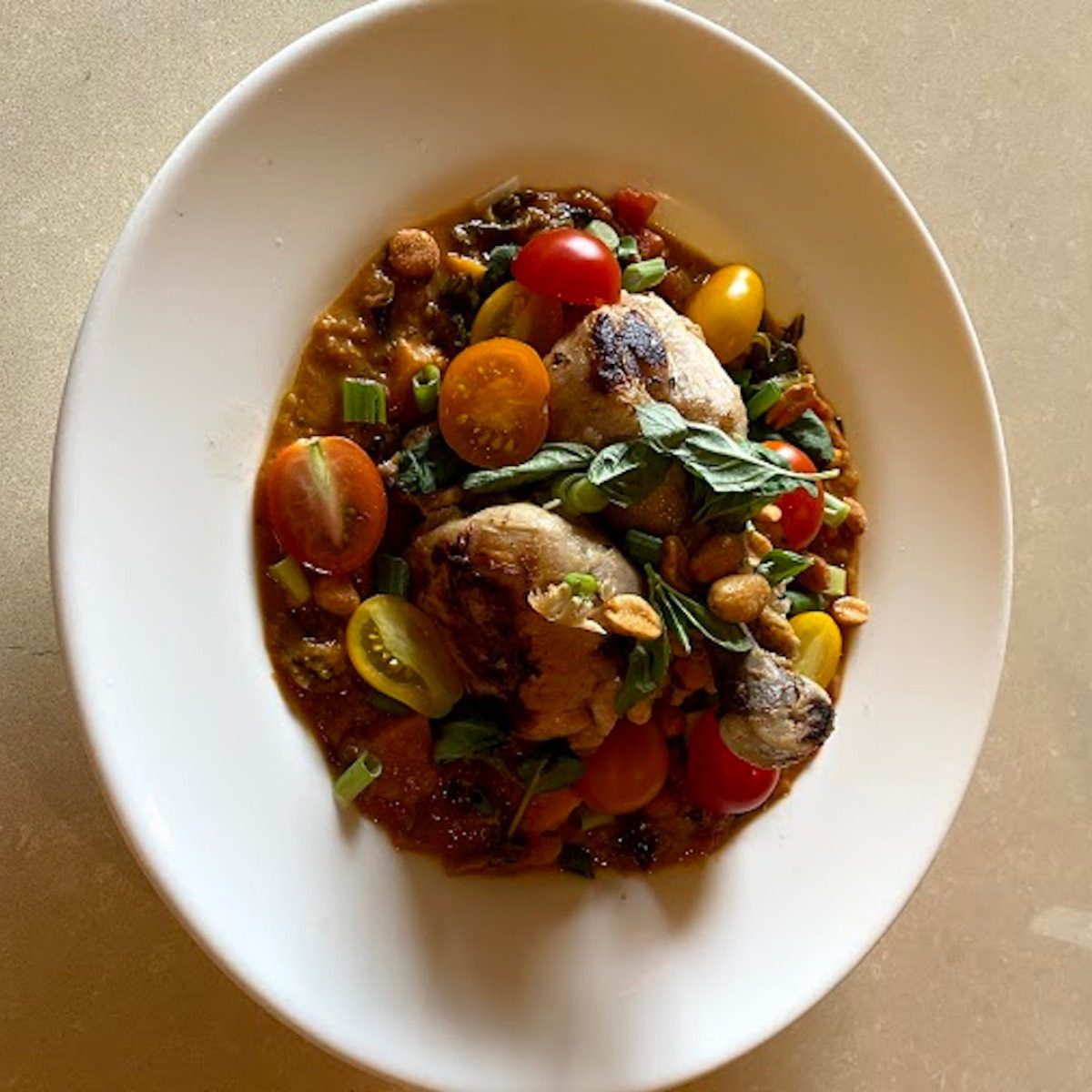 West African-Inspired Peanut Stew with Confit Chicken